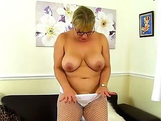 Matures Blonde Woman With Glasses Is Masturbating On The Couch, While She Is Alone At Home